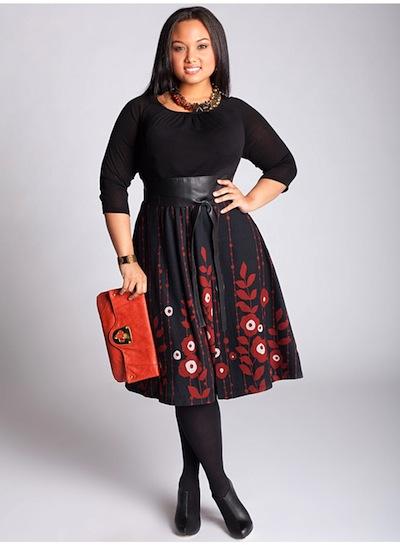 Schwarzes, tailliertes Kleid mit einem expressiv gemusterten Rocksaum